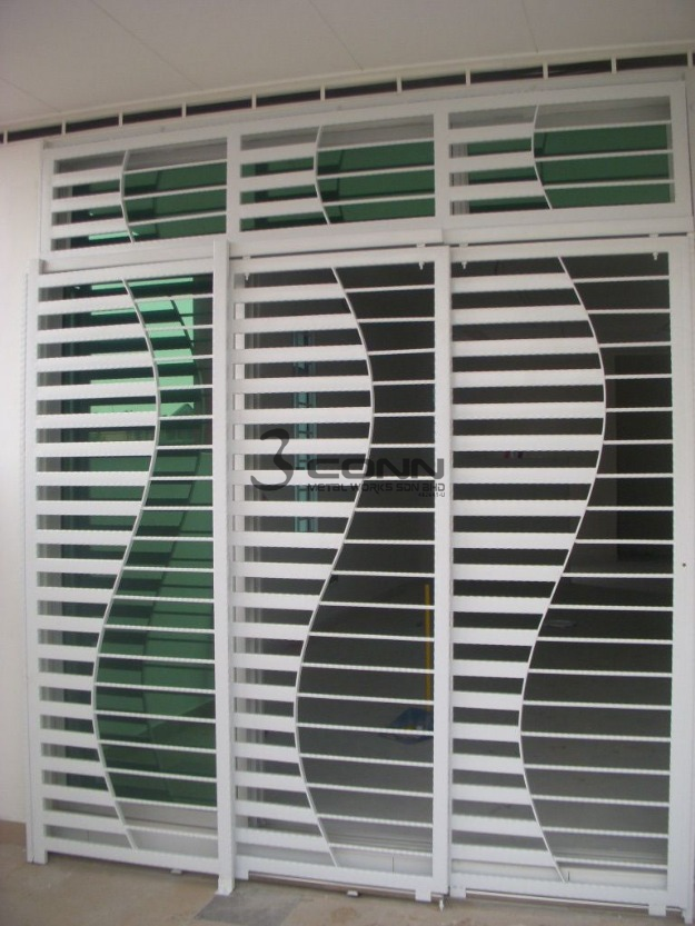 Steel door grills design pictures modern house for Modern zen window grills design